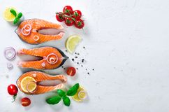 Raw fresh salmon steak with vegetables. Ingredients for cooking on white background. Space for text. Diet and healthy. Food concept. Banner Royalty Free Stock Photos