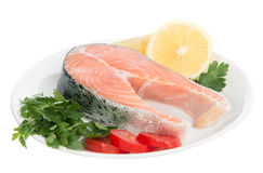 Raw fresh salmon steaks red fish on a plate Royalty Free Stock Photography