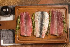 Raw Fresh Sardine Fillet. Over a wooden board Royalty Free Stock Image