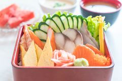 Raw fresh sashimi with rice in bento box Stock Photography