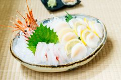 Raw and fresh sashimi set with hotate oyster and prawn or shrimp. Japanese food style Royalty Free Stock Photos