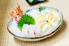 Raw and fresh sashimi set with hotate oyster and prawn or shrimp. Japanese food style Stock Photos