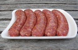 Raw sausages on styrofoam tray. Fresh raw sausages on white styrofoam tray Royalty Free Stock Photos