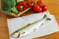 Raw fresh trout lying on a wooden table Stock Photo