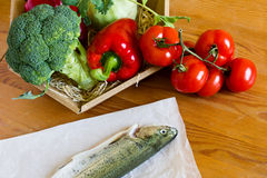 Raw fresh trout lying on a wooden table Stock Photos