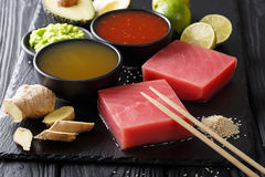 Raw fresh tuna fillet with chili and pineapple sauces and other. Ingredients for cooking close-up on the table. horizontal background Royalty Free Stock Photos