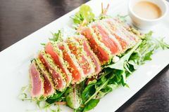 Tuna salad. Raw and fresh tuna meat with vegetable salad in white plate - Healthy food style Royalty Free Stock Images