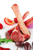 Raw fresh veal ribs. Served raw fresh veal ribs with vegetables Royalty Free Stock Images