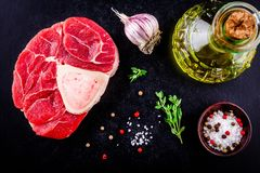 Raw fresh veal shank meat for ossobuco. On dark background Royalty Free Stock Images