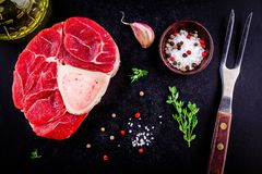 Raw fresh veal shank meat for ossobuco. On dark background Royalty Free Stock Photography