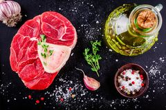 Raw fresh veal shank meat for ossobuco. On dark background Royalty Free Stock Photos