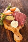 Soup ingredients on wooden table. Raw Fresh vegetables and raw meat on wooden board. Soup ingredients Royalty Free Stock Photography