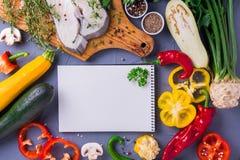 Raw fresh white fish steak with vegetables ingredients Stock Photos