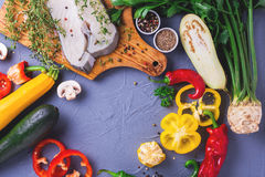 Raw fresh white fish steak with vegetables ingredients Royalty Free Stock Image