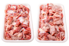 Raw frozen chicken gizzard in  plastic plate. Isolated on white Stock Photos
