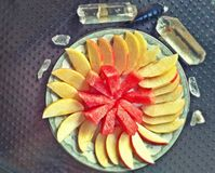 Raw Fruit Art - Ceremony. This is 1 gala apple and a slice of watermelon gracefully intentionally displayed for the reciever to feel the love that is shared Stock Photos