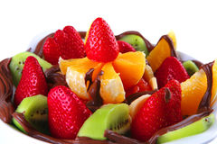 Raw fruits with chocolate. Tropical raw fruits with in hot chocolate cream Stock Photo