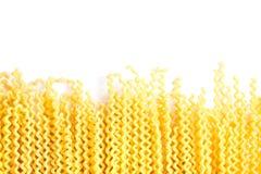 Raw fusilli bucati lunghi italian pasta on white background. Uncooked dry fusilli bucati lunghi italian pasta on white background stock image
