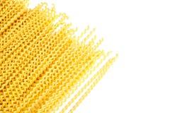 Raw fusilli bucati lunghi italian pasta on white background. Uncooked dry fusilli bucati lunghi italian pasta on white background stock photography