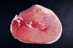 Raw gammon steak on black stone background Royalty Free Stock Photography