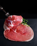 Raw gammon steak on black stone background Royalty Free Stock Photo