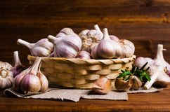 Raw garlic cloves. In a box on wooden background. Selective focus Royalty Free Stock Photography