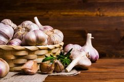 Raw garlic cloves. In a box on wooden background. Selective focus Stock Image