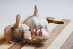 Raw garlic on the cutting board Stock Images