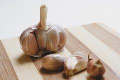 Raw garlic on the cutting board Royalty Free Stock Photo