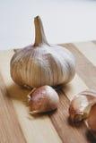 Raw garlic on the cutting board Stock Photo