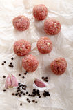 Raw garlic meat balls on white paper Stock Images