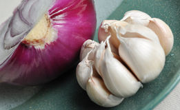 Raw Garlic and onion Stock Images