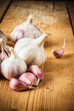 Raw garlic on wooden background Royalty Free Stock Photo