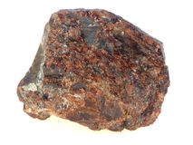 Raw garnet. Garnet is decorative and valuable stone. This sample of raw garnet was found on the coast of white sea stock images