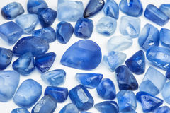 Raw gemstones. Raw blue sapphires with white background Royalty Free Stock Photo