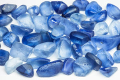 Raw gemstones. Raw blue sapphires with white background Stock Photography