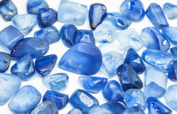 Raw gemstones. Raw blue sapphires with white background Stock Photos