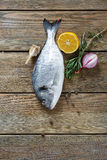 Raw gilthead with spices on the boards Royalty Free Stock Photography