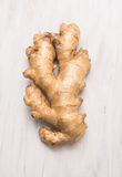 Raw Ginger root  on white wooden background. Top view Royalty Free Stock Photo