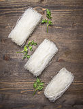 Raw glass noodles with herbs wooden rustic background top view close up Stock Photography