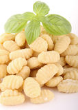 Raw gnocchi. With basil on white background Royalty Free Stock Image