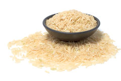 Raw  grain organic jasmine rice in black bowl Royalty Free Stock Images