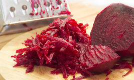 Raw grated beets. On a wooden board Stock Photography