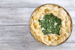Raw greek spinach feta cheese pie royalty free stock images