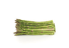 Raw Green Asparagus. Fresh raw green asparagus bunch lying on white Royalty Free Stock Photos