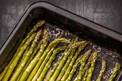 Raw green asparagus. Spears in a black cooking tray Royalty Free Stock Image