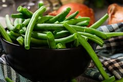 Raw green beans in a black dish. Healthy food Stock Images