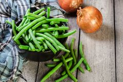 Raw green beans in a black dish. Healthy food. Top view Royalty Free Stock Images