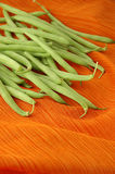 Raw Green Beans on Orange Stock Photo