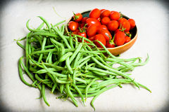Raw green french beans and red tomatoes Stock Photos